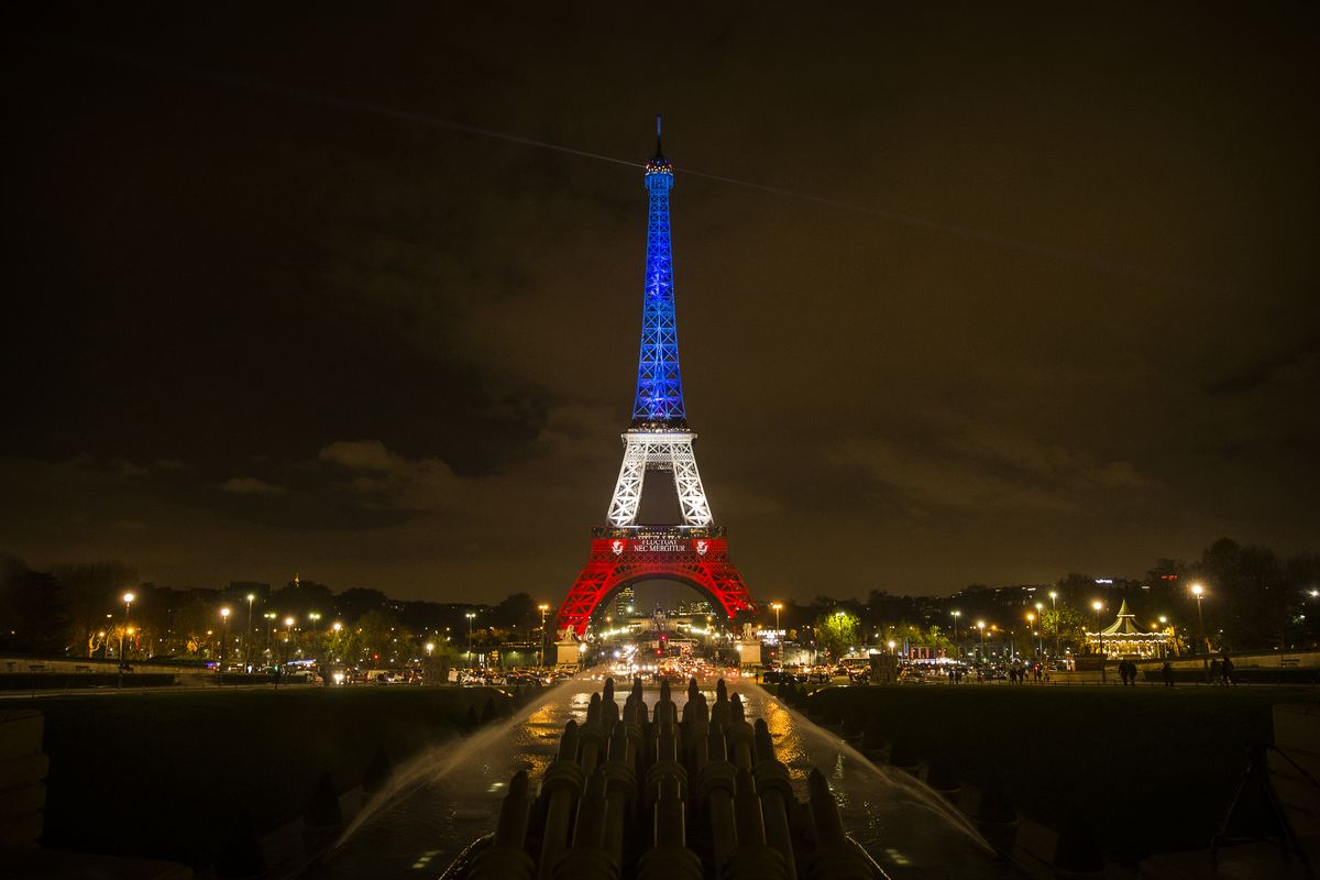 epa05028805 The Eiffel Tower is illuminated in the colors of the French flag in tribute for the victims of the 13 November terror attacks, in Paris, France, 16 November 2015. At least 132 people were killed and some 350 injured in the terror attacks on 13 November, which targeted a concert venue, a sports stadium, and several restaurants and bars in Paris. Authorities believe that three coordinated teams of terrorists armed with rifles and explosive vests carried out the attacks, which the Islamic State (IS) extremist group has claimed responsibility for.  EPA/ETIENNE LAURENT