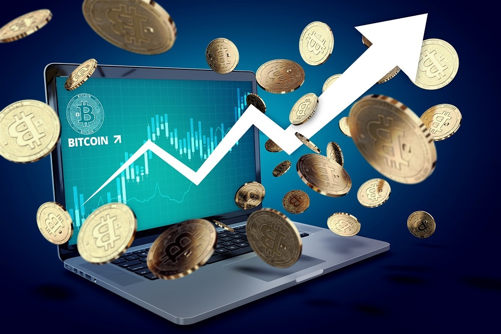 "Floating Bitcoin coins against laptop with BTC success chart on-screen and arrow pointing up. Bitcoin heading ""to the moon"" concept. 3D illustration"