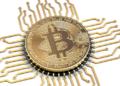 Bitcoin conectado a una computadora. Fuente: maxxyustas/ Envato Elements.