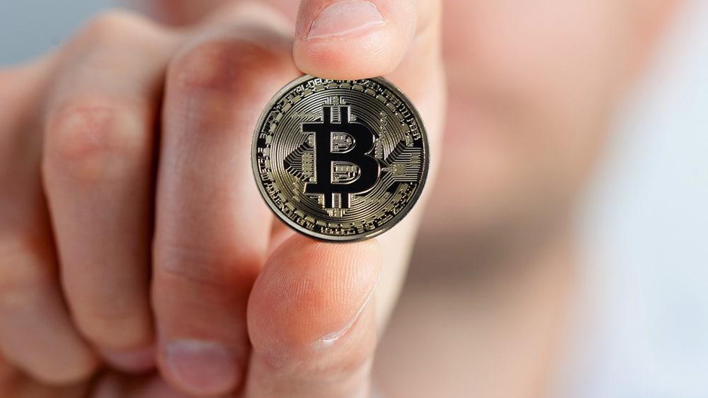 bitcoin mano criptomoneda saludable