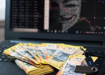 Hacker observando por pantalla dinero y monedero ledger. Composición por CriptoNoticias. Javad Rajabzade / Pixabay.com ; marowl / elements.envato.com
