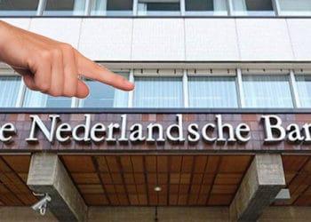Mano señalando sobre imagen del Banco central de Holanda. Composición por CriptoNoticias. Anti Lavado de dinero / antilavadodedinero.com; Tumisu / Pixabay.com