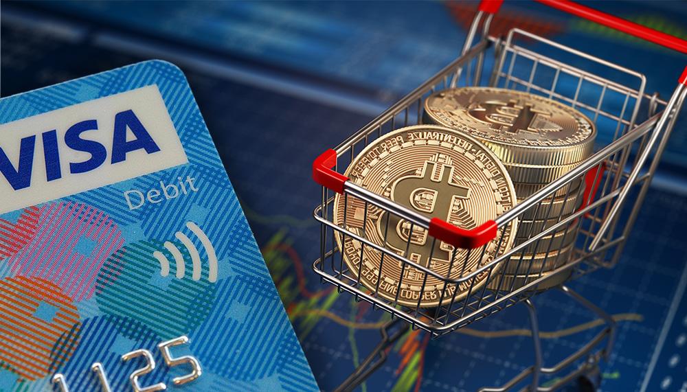 Tarjeta visa junto a carrito de mercado con monedas de bitcoin sobre tablet con gráfico de mercado. Composición por CriptoNoticias. Miloslav Hamřík / pixabay.com; maxxyustas / elements.envato.com.