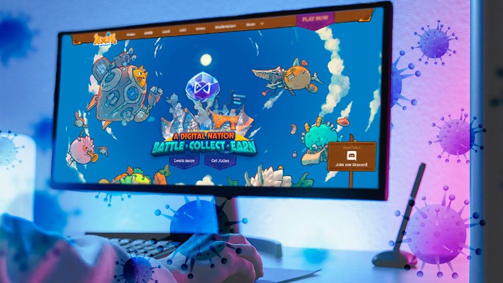 Juego Axie en pantalla y virus de COVID.