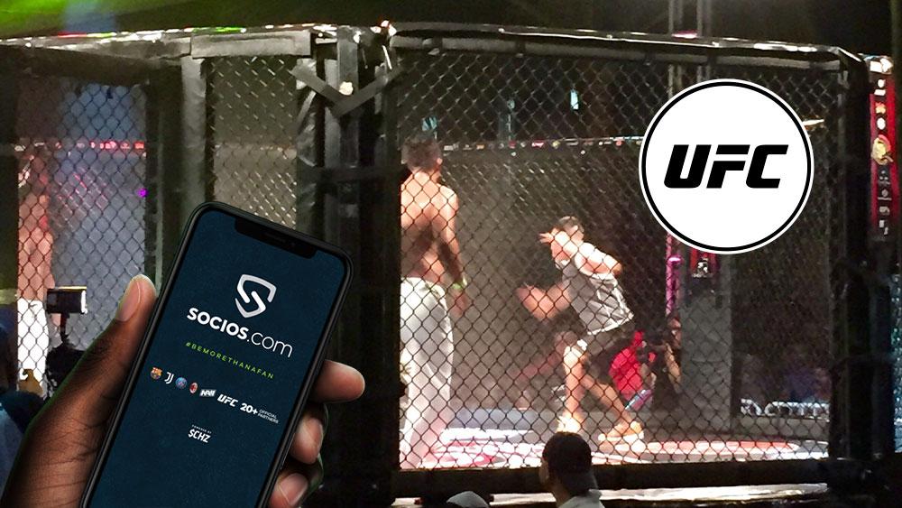 Pelea de UFC con su respectivo token y mano sosteniendo teléfono con pantalla de socios.com.