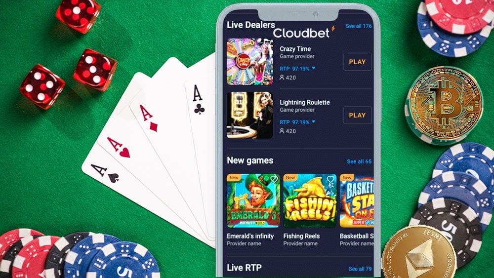 Mesa de juegos de casino, bitcon y ether, y teléfono inteligente con CLoudbet en pantalla.