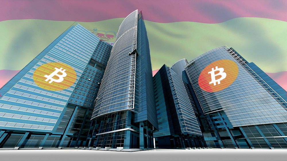 Banco con bitcoin y bandera de España.