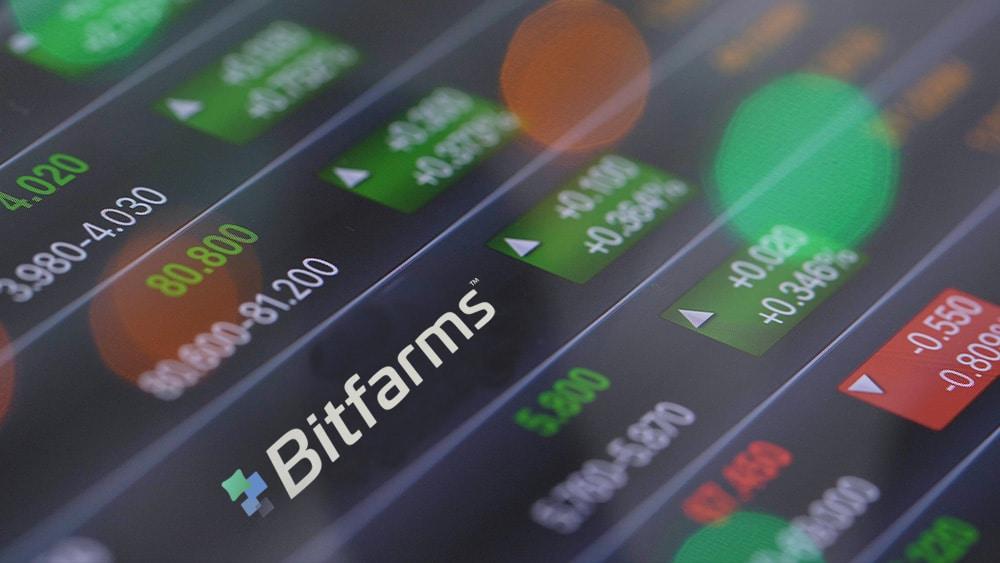 Tabla de acciones y logo de bitfarms.