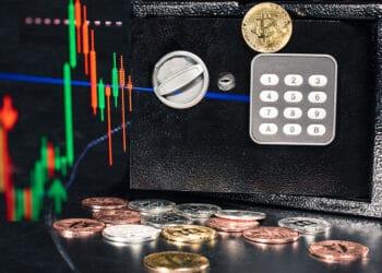 Caja fuerte con bitcoins y gráfico.