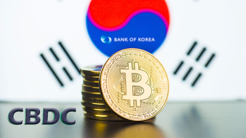 Bitcoins con bandera de Corea del Sur y logo del Bank of Korea, a un lado letras CBDC.