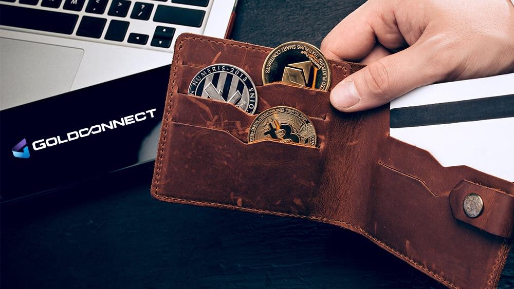 Cartera con criptomonedas y logo de Goldconnect.
