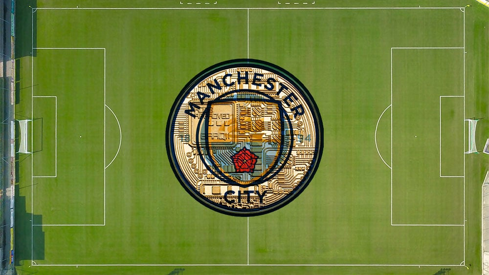 Campo de fútbol con logo e Manchester City.