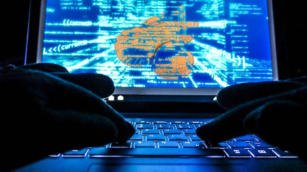 Hacker con XRP en la pantalla.
