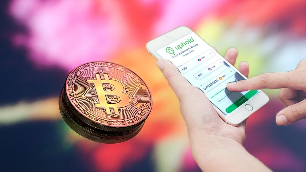 Bitcoin y teléfono con Uphold.
