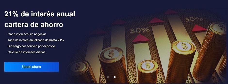 Pilas de monedas sobre gráfico de barras promocionando cartera Bexplus con intereses.