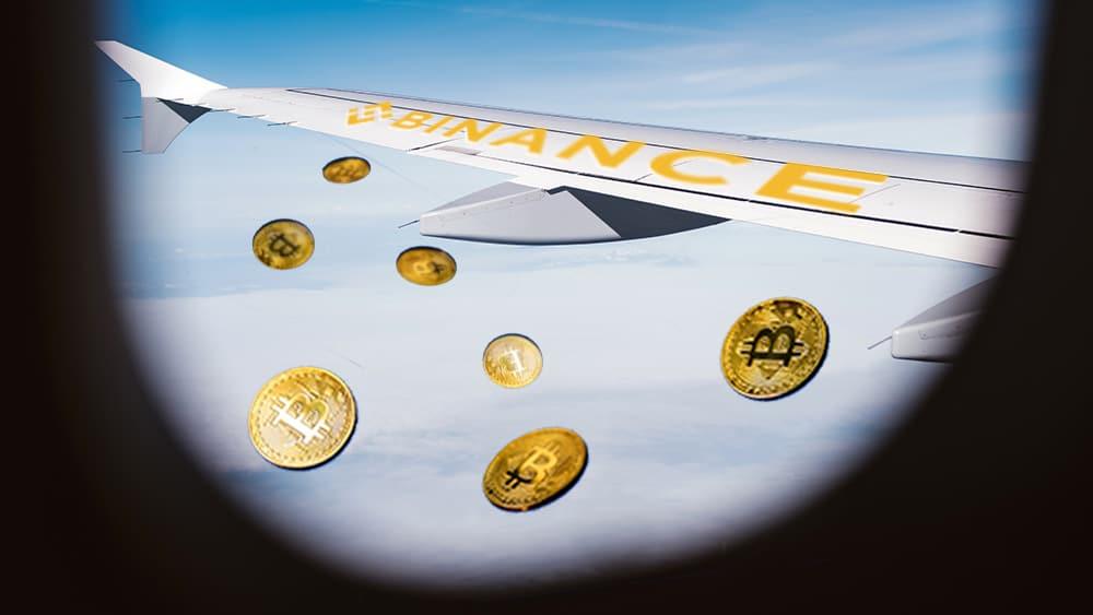 Avión con logo de Binance y btc cayendo del cielo.