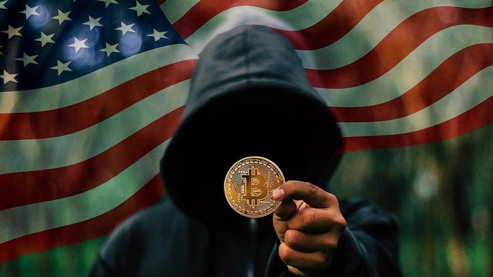 Hacker con bitcoin y bandera USA.