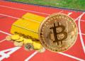 Oro y bitcoin en pista de atletismo.
