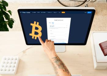 Huobi en pantalla con logo de BTC y billetera.